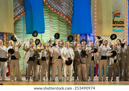 CANARY ISLAND, SPAIN - FEBRUARY 13, 2015: Folklore group Los Gofiones performing onstage during city of Las Palmas carnival One Thousand and One Nights opening show of Queens Gala. - stock photo