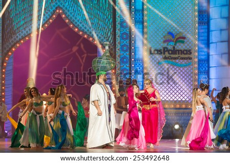 CANARY ISLAND, SPAIN - FEBRUARY 13, 2015: Lili Quintana from Las Palmas with a book (m) and unidentified dancers during Las Palmas carnival One Thousand and One Nights opening show of Queens Gala. - stock photo