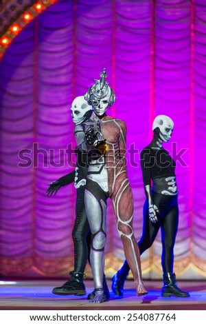 CANARY ISLAND, SPAIN - FEBRUARY 17, 2015: Nadine Ruegg Gonzalez (m) and her assisters onstage during city of Las Palmas carnival One Thousand and One Nights Body Painting Contest. - stock photo