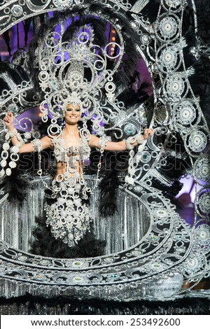 CANARY ISLAND, SPAIN - FEBRUARY 13, 2015: Yaiza Artiles Calero onstage with costume from designer Willie Diaz during city of Las Palmas carnival One Thousand and One Nights Queens Gala show. - stock photo