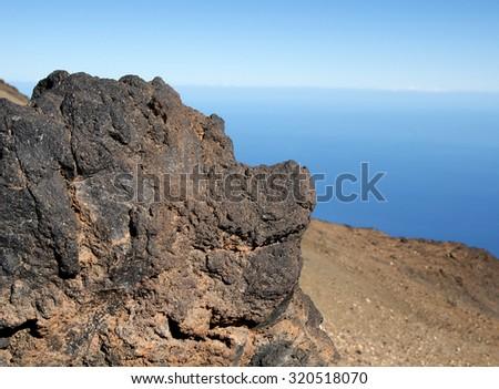 Canary Island (Tenerife) volcanic stone on the shore backgroudn - stock photo