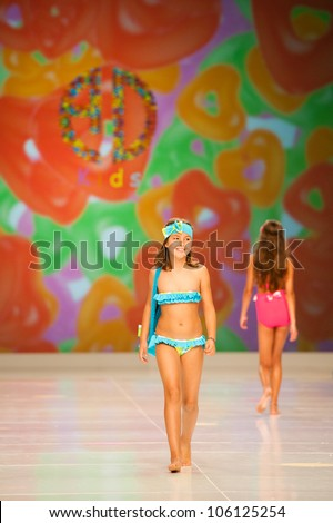 CANARY ISLANDS -JUNE 22: Unidentified models walks the runway in Alida Dominguez Baby collection during Gran Canaria Moda Calida swimwear fashion show on June 22, 2012 in Canary Islands, Spain - stock photo