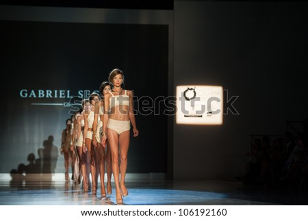 CANARY ISLANDS -JUNE 22: Unidentified models walks the runway in the Gabriel Segui collection during Gran Canaria Moda Calida swimwear fashion show on June 22, 2012 in Canary Islands, Spain - stock photo