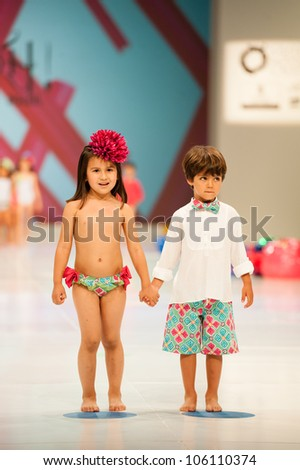 CANARY ISLANDS -JUNE 22: Unidentified models walks the runway in the Oh! Soleil collection during Gran Canaria Moda Calida swimwear fashion show on June 22, 2012 in Canary Islands, Spain - stock photo