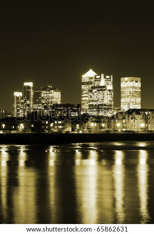 Canary Wharf at dusk, Famous skyscrapers of London's financial district by night. - stock photo