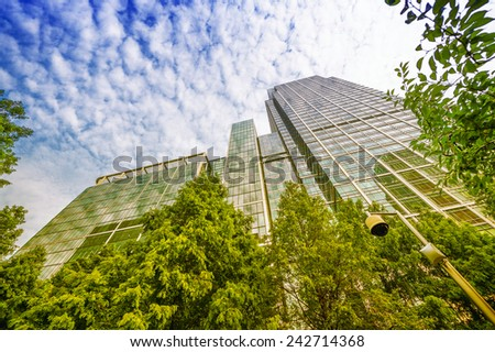 Canary Wharf. Beautiful view of Skyscrapers and trees from street level - London. - stock photo