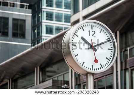 Canary Wharf clock detail. Canary Wharf is a major business district with around 14,000,000 square feet of office and retail space.  - stock photo