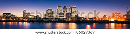 Canary Wharf , Famous skyscrapers of London's financial district at twilight. - stock photo