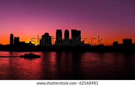 Canary Wharf, Famous skyscrapers of London's financial district. This view includes: Credit Suisse, Morgan Stanley, HSBC Group Head Office, Canary Wharf Tower, Citigroup Centre. Silhouette (Blacklit) - stock photo