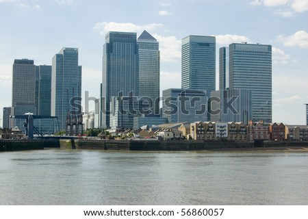 Canary Wharf, London Docklands,  View across the River Thames at North Greenwich towards Canary Wharf.  The offices house many banking and finance companies. - stock photo