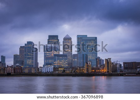Canary Wharf, London's major financial district at blue hour - London, UK - stock photo