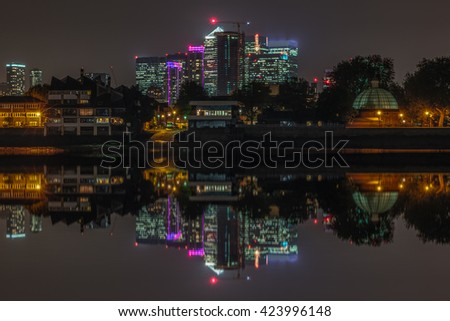 Canary Wharf view at night from Greenwich Pier, London - stock photo