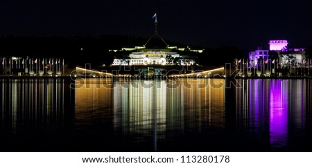 Canberra Skyline with a reflection in the waters of Lake Burley Griffin - stock photo