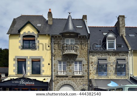 CANCALE, FRANCE - JUNE 10: Facade with different Buildings in the picturesce village in Brittany, on June 10, 2011 in Cancale, France