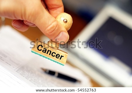 cancer concept with stamp in hospital office and copyspace - stock photo