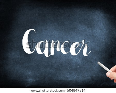 Cancer written on a blackboard