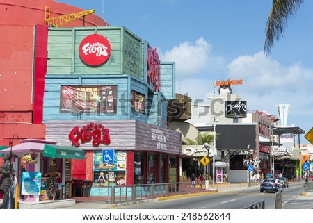 CANCUN - JANUARY 22: The main street of the hotel zone close to the beach on 22 January 2015 in Cancun, Mexico. In this street is a lot of stores and restaurants for tourists from all over the world. - stock photo