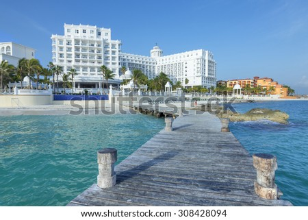 CANCUN, MEXICO - JULY 30, 2015:  Seaside resorts such as Hotel Riu Palace continue to offer quality five-star accommodations along the beautiful Caribbean coastline of Cancun's hotel zone - stock photo
