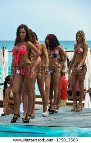CANCUN, MEXICO - MAY 03: Models walking runway during semi-finals IBMS 2014 at the Mandala Beach Resort  on May 03, 2014 in Cancun, Mexico.