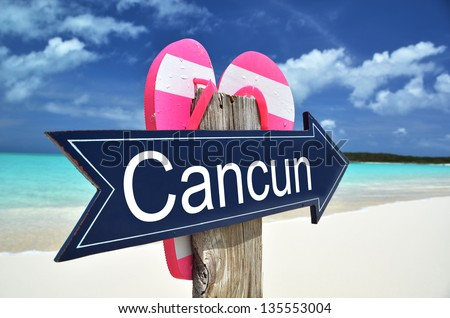 CANCUN sign on the beach - stock photo