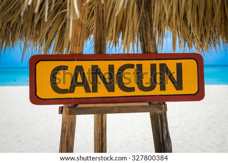 Cancun sign with beach background - stock photo