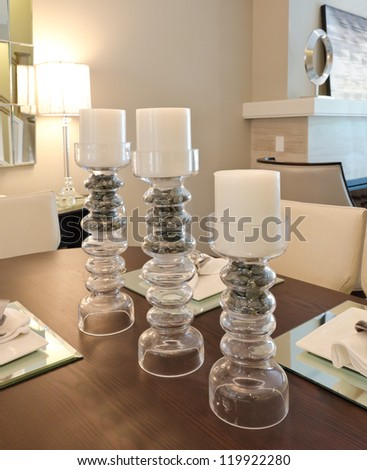 Candelabrums on the living ( lunch ) room table . - stock photo