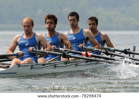 CANDIA, TURIN, ITALY - MAY 22: the CUS Torino quad (quadruple) scull (4x) crew rowing during 2011 Rowing CNU University National Championship on May 22, 2011 on Candia lake, Turin, Italy