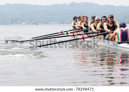 CANDIA, TURIN, ITALY - MAY 22: the octuple scull (8x) coxed CUS Milano crew rowing during 2011 Rowing CNU University National Championship on May 22, 2011 on Candia lake, Turin, Italy