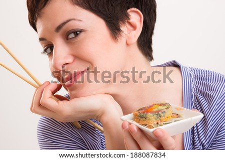 Candid Close Portrait Cute Brunette Woman Raw Food Sushi Lunch - stock photo