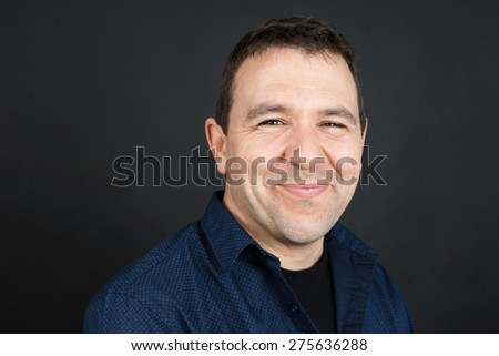 Candid portrait of a friendly sympathetic smiling man