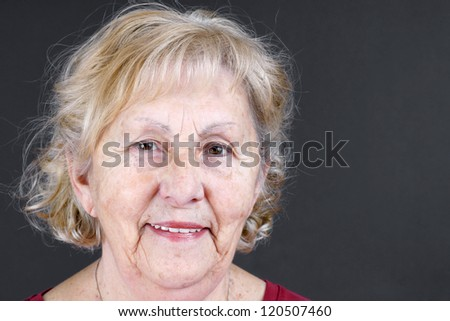 Candid portrait of real person, a smiling senior citizen or old woman, no retouching great details. - stock photo