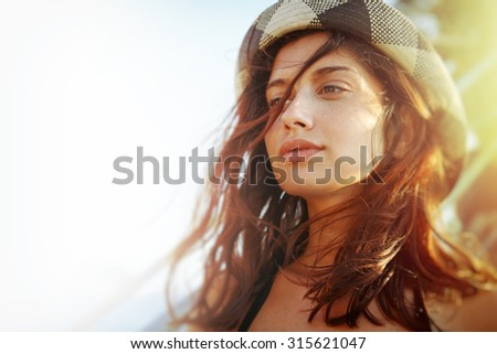 Candid summer portrait of beautiful teen girl