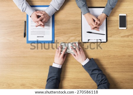 Candidate bribing the employer during a job interview, corruption concept, top view - stock photo
