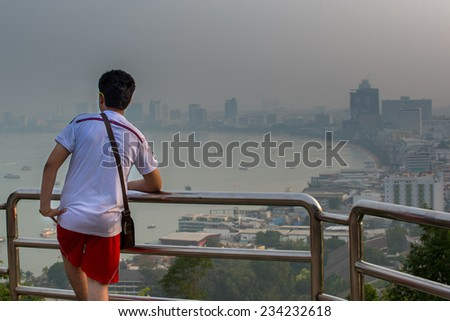 Candidate to stand lookout.Watch the boats in the marina bay morning holiday. - stock photo