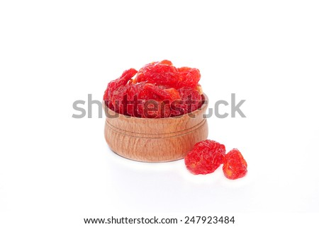 Candied berries of dogwood in wooden bowl, isolated on white - stock photo