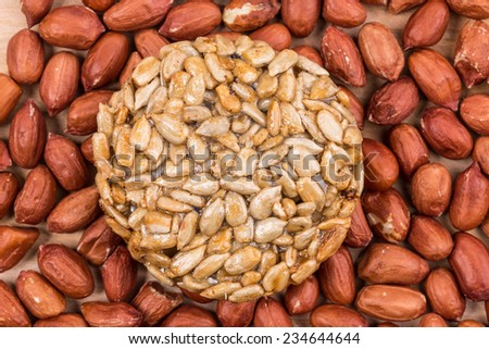 Candied sunflower seeds on peanuts. Whole background.