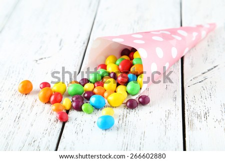Candies on white wooden background - stock photo