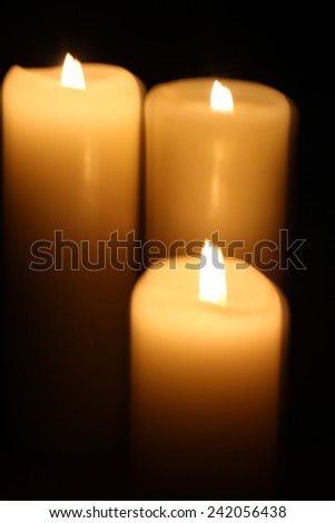 Candle and candlelight in the dark