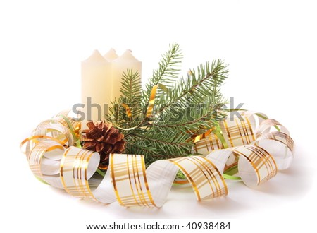 Candle and decoration isolated on white