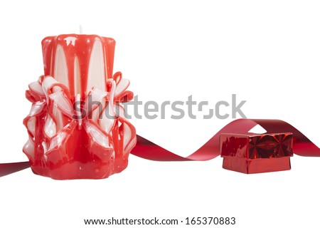 Candle and gift box on white background.  Gift box with red ribbon.