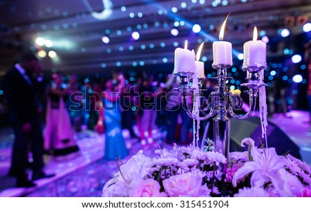 Candle at the event or wedding party with - stock photo