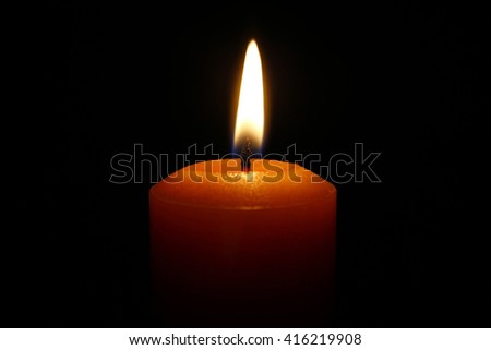 Candle closeup in a black background,  memorial - stock photo