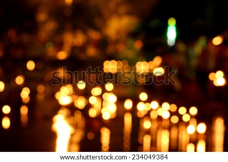 Candle de focus or bokeh background. - stock photo