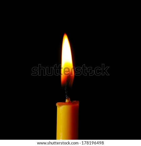 candle flame at night closeup - isolated on black background - stock photo