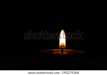 candle flame on a black background - stock photo
