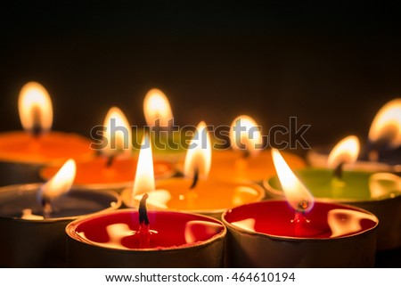 candle flames glowing in the dark. candle light on wooden table.