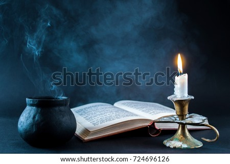 stock-photo-candle-in-candlestick-burnin