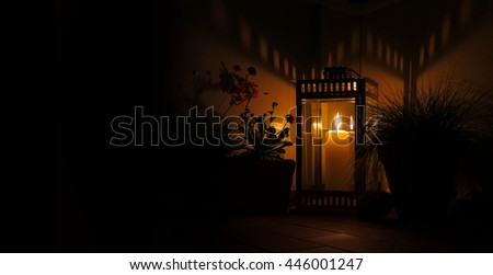 candle in lantern by night with copy space