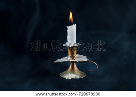 stock-photo-candle-in-old-candlestick-an