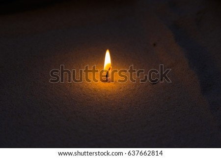 Candle in the sand. Soft Focus